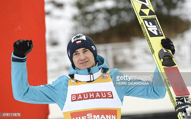 Poland's Kamil Stoch celebrates winning the Ski Jumping Large Hill Individual event at the FIS World Cup in Lahti Ski Games in Lahti, Finland on...