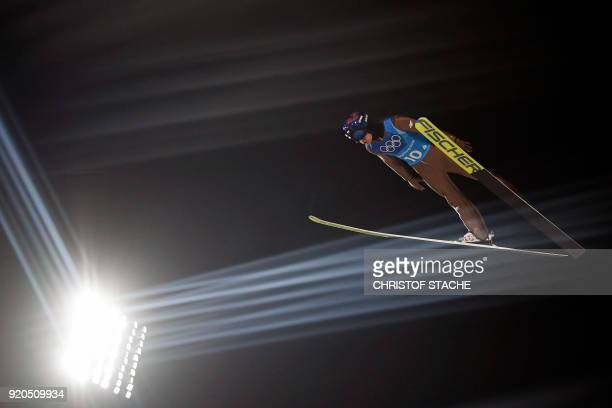 Poland's Kamil Stoch competes in the men's large hill team ski jumping trial round for competition event during the Pyeongchang 2018 Winter Olympic...