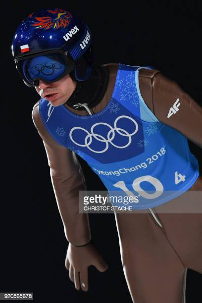 Poland's Kamil Stoch competes in the men's large hill team ski jumping first round for competition event during the Pyeongchang 2018 Winter Olympic...