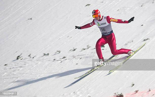 Poland's Kamil Stoch finishes his jump as he competes during the first run of the FIS Ski Jumping World Cup in Vikersund Norway on January 26 2013...