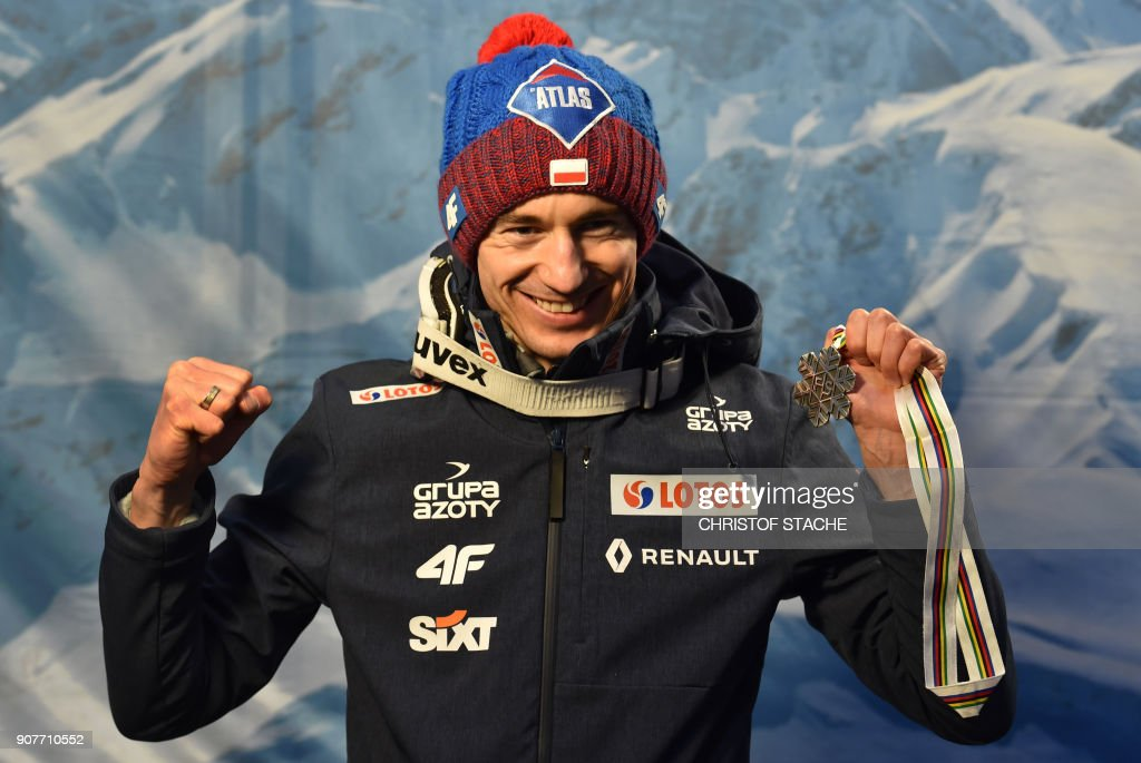 Poland's Kamil Stoch poses with his silver medal after placing second in the individual competition of the ski-flying world championships in Oberstdorf, southern Germany, on January 20, 2018. /
