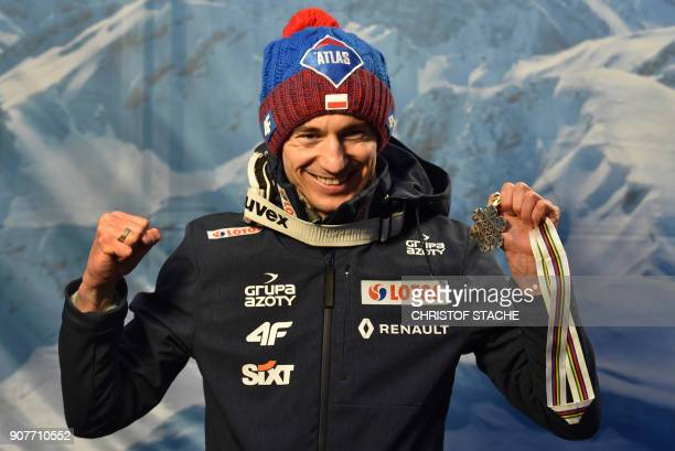Poland's Kamil Stoch poses with his silver medal after placing second in the individual competition of the skiflying world championships in...