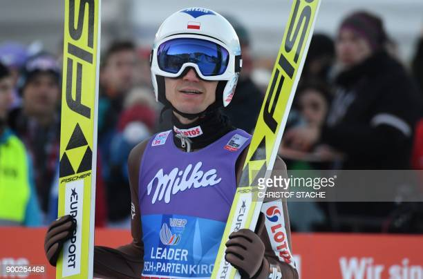 Poland's Kamil Stoch reacts after his competition jump to win the ski jumping event in GarmischPartenkirchen southern Germany which was the second...