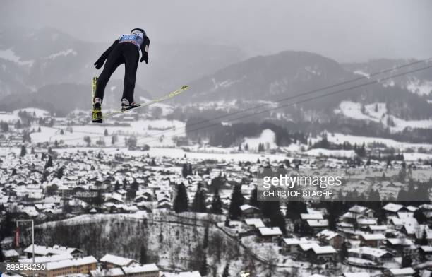 Poland's Kamil Stoch soars through the air during his training jump of the the ski jumping event in Oberstdorf southern Germany which was the first...