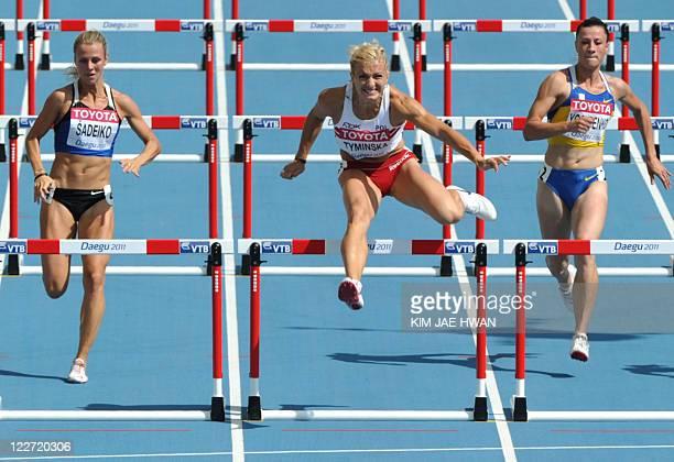 Poland's Karolina Tyminska competes with Estonia's Grit Sadeiko and Ukraine's Lyudmyla Yosypenko in the 100 metres hurdles of the women's heptathlon...