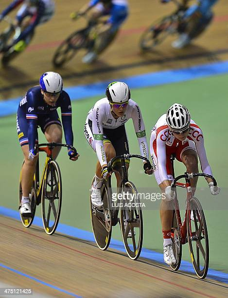 Poland's Katarzyna Pawlowska Ashlee Ankudinoff and Laurie Berton compete during the Women's scratch race at the UCI track cycling World Cup...