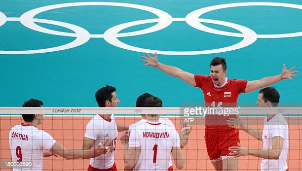 Poland's Krzysztof Ignaczak celebrates with teammates during their men's quarterfinal volleyball match of the London 2012 Olympic Games at the Earl's...