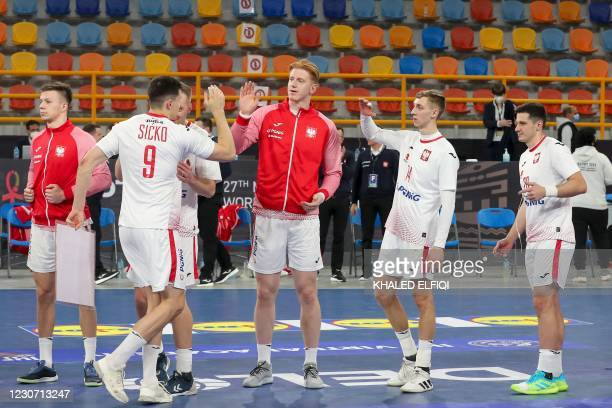 Poland's left back Szymon Sicko celebrates his award with teammates during the 2021 World Men's Handball Championship between Group I teams Uruguay...