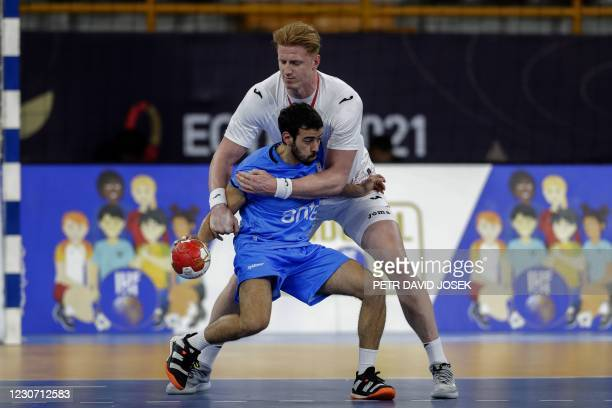 Poland's left back Tomasz Gebala vies for the ball with Uruguay's centre back Rodrigo Botejara during the 2021 World Men's Handball Championship...
