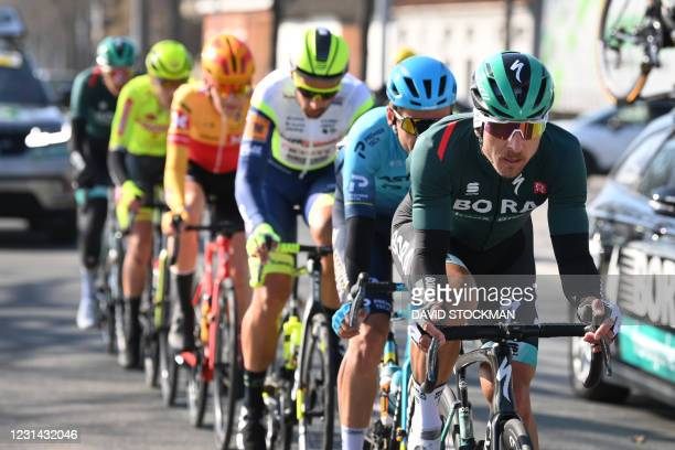 Poland's Maciej Bodnar of Bora-Hansgrohe leads a group of riders during the Kuurne-Brussels-Kuurne one day cycling race - 197kms from Kuurne to...