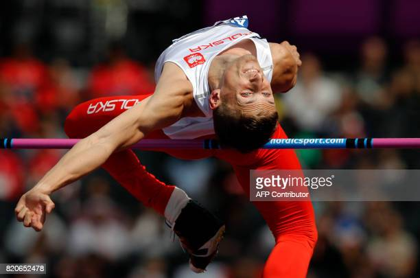 Poland's Maciej Lepiato competes in the Men's High Jump T44 Final during the World Para Athletics Championships in London on July 22 2017 / AFP PHOTO...