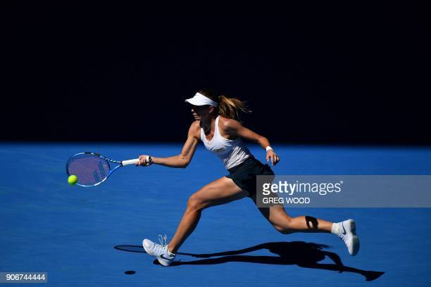 Poland's Magda Linette hits a return during her women's singles third round match against Czech Republic's Denisa Allertova on day five of the...