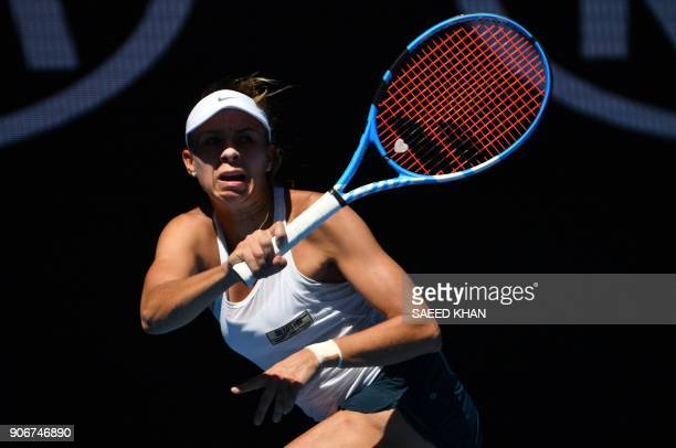 Poland's Magda Linette hits a return during their women's singles third round match against Czech Republic's Denisa Allertova on day five of the...