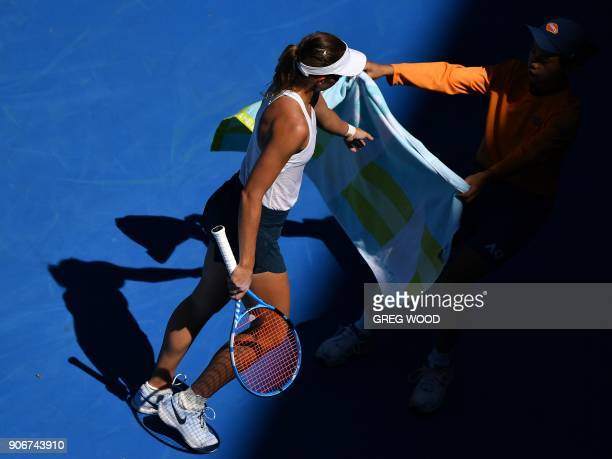 Poland's Magda Linette receives a towel during her women's singles third round match against Czech Republic's Denisa Allertova on day five of the...