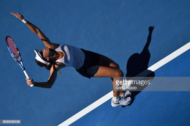 Poland's Magda Linette serves to Czech Republic's Denisa Allertova during their women's singles third round match on day five of the Australian Open...