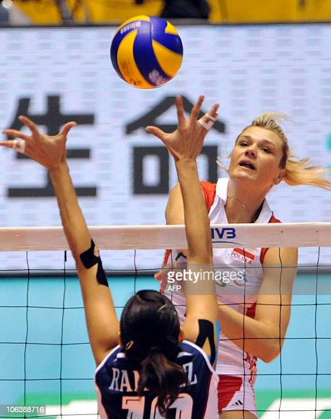 Poland's Malgorzata GlinkaMogentale spikes the ball to Paola Ramirez Vargas of Costa Rica during the first round of the world woman's volleyball...