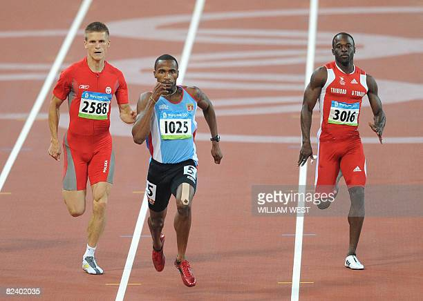 Poland's Marcin Jedrusinski Antigua's Brendan Christian and Trinidad and Tobago's Aaron Armstrong compete during the men's 200m round 2 heat 3 at the...