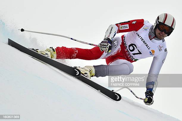 Poland's Michal Klusak competes during the men's SuperG event of the 2013 Ski World Championships in Schladming Austria on February 6 2013 AFP PHOTO...