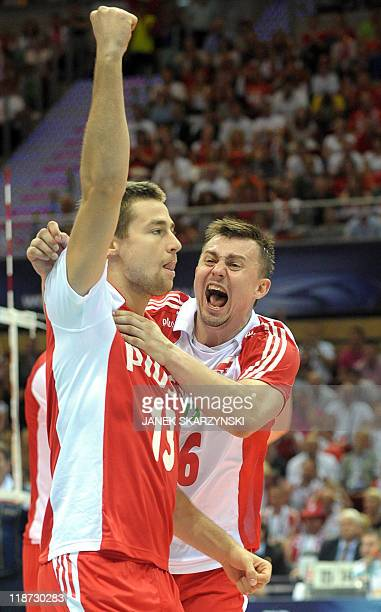 Poland's Michal Kubiak and Krzysztof Ignaczak react after winning their Volleyball World League bronze medal game against Argentina in Gdansk on July...