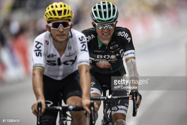 Poland's Michal Kwiatkowski and Poland's Rafal Majka injured after falling cross the finish line at the end of the 1815 km ninth stage of the 104th...