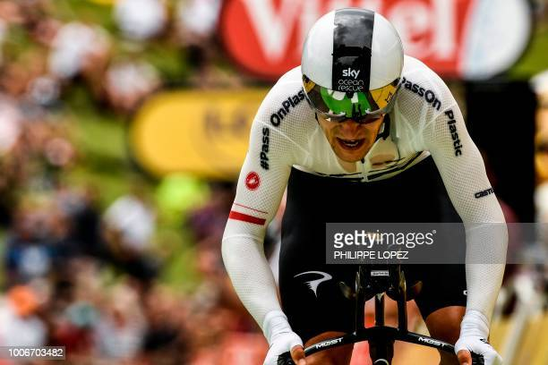 Poland's Michal Kwiatkowski crosses the finish line of the 20th stage of the 105th edition of the Tour de France cycling race, a 31-kilometer...