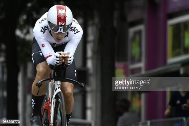 Poland's Michal Kwiatkowski rides during a 66 km individual timetrial the prologue of the 70th edition of the Criterium du Dauphine cycling race on...