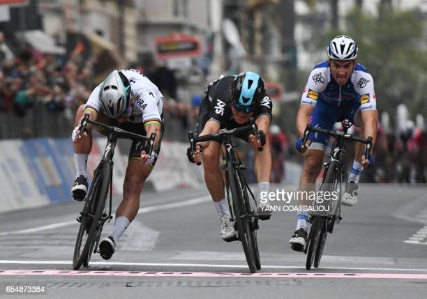 TOPSHOT Poland's Michal Kwiatkowski sprints to win the 108th edition of the Milan San Remo cycling race ahead of Slovakia's Peter Sagan and France's...