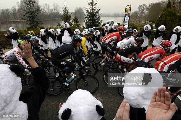 Poland's Michal Kwiatkowski wearing the overall leader's yellow jersey rides in the pack as cyclists take the start of the second stage of the 73rd...