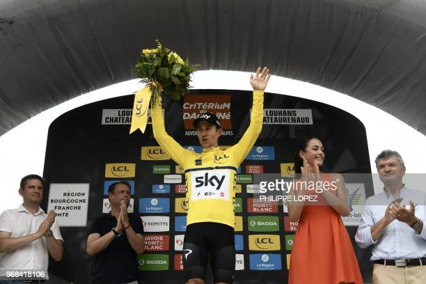 Poland's Michal Kwiatkowski, wearing the overall leader's yellow jersey, celebrates on the podium after Great Britain's Sky cycling team won the...