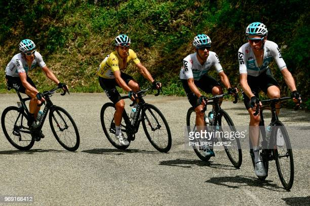 TOPSHOT Poland's Michal Kwiatkowski wearing the overall leader's yellow jersey rides with his Great Britain's Sky cycling team teammates during the...