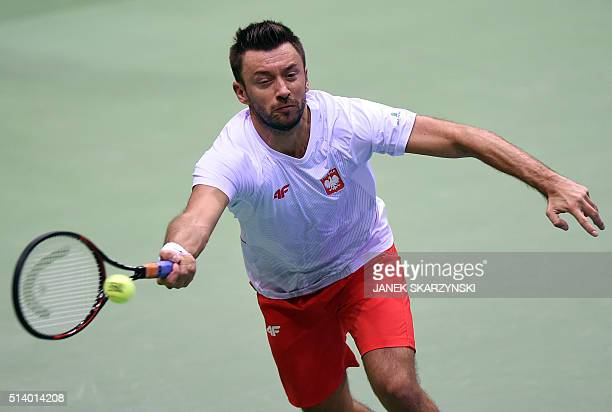 Poland's Michal Przysiezny plays a return against Argentina's Leonardo Mayer during the Davis Cup World Group firstround tennis match between Poland...