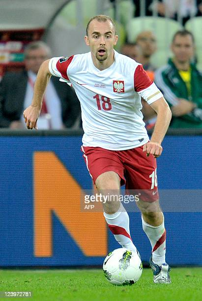 Poland's midfielder Adrian Mierzejewski runs with the ball during the International friendly football match Poland vs Germany in the northern Polish...