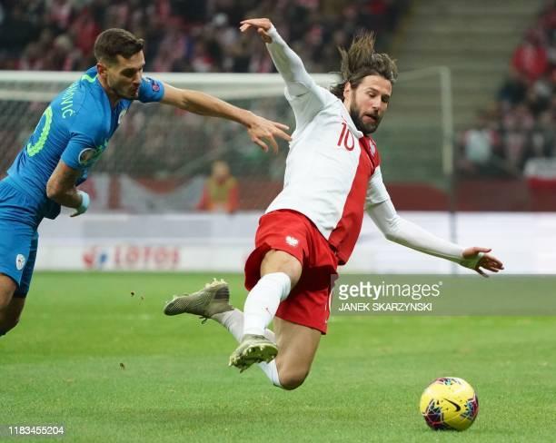 Poland's midfielder Grzegorz Krychowiak and Slovenia's defender Petar Stojanovic vie for the ball during the UEFA Euro 2020 qualifier Group G...