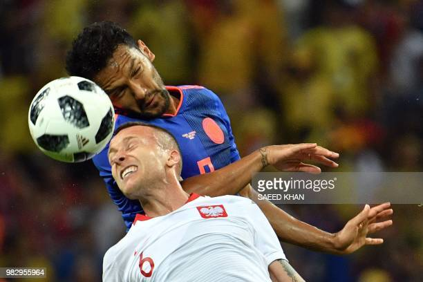 Poland's midfielder Jacek Goralski heads the ball with Colombia's midfielder Abel Aguilar during the Russia 2018 World Cup Group H football match...