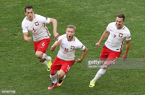 TOPSHOT Poland's midfielder Jakub Blaszczykowski celebrates after scoring during the Euro 2016 group C football match between Ukraine and Poland at...