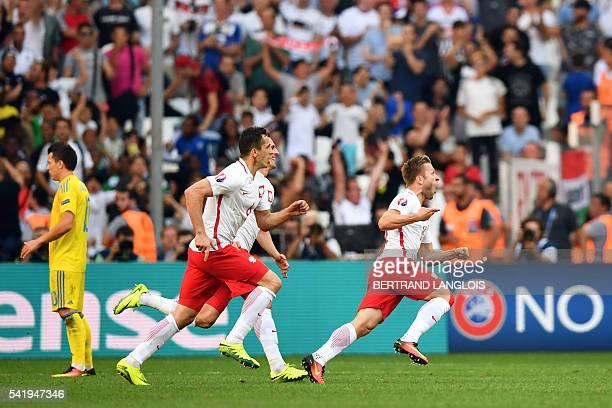 Poland's midfielder Jakub Blaszczykowski celebrates after scoring the first goal during the Euro 2016 group C football match between Ukraine and...