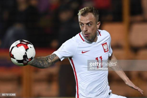 Poland's midfielder Kamil Grosicki eyes the ball during the FIFA World Cup 2018 qualification football match between Armenia and Poland in Yerevan on...