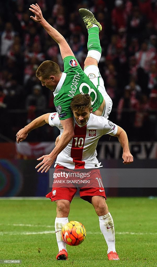 Poland's midfielder Karol Linetty (bottom) and Ireland's midfielder James McCarthy (up) vie for the ball during the Euro 2016 Group D qualifying football match between Poland and the Republic of Ireland at the Stadion Narodowy in Warsaw on October 11, 2015.