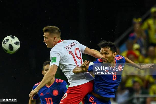 Poland's midfielder Piotr Zielinski vies with Colombia's midfielder Abel Aguilar during the Russia 2018 World Cup Group H football match between...