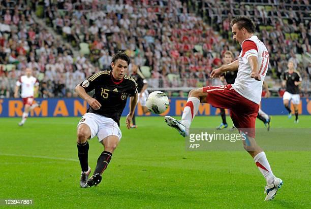 Poland's midfielder Slawomir Peszko and Germany's defender Christian Traesch vie for the ball during the International friendly football match Poland...