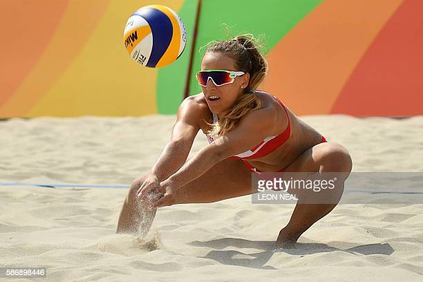 TOPSHOT Poland's Monika Brzostek controls the ball during the women's beach volleyball qualifying match between Poland and the USA at the Beach...