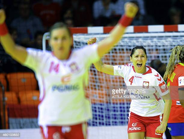 Poland's Monika Stachhowska celebrates her score during the first match Spain vs Poland of the 2014 European Women's Handball Championships at the...