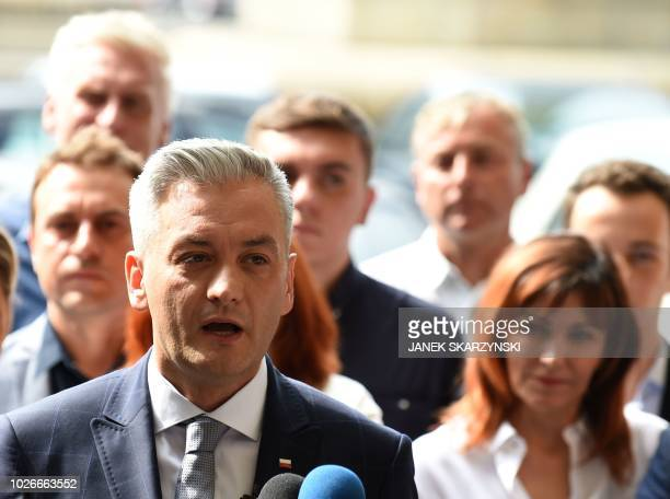 Poland's most prominent gay politician Robert Biedron speaks to the media during a press conference in Warsaw on September 4 2018 An openly gay...