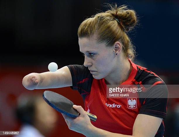 Poland's Natalia Partyka serves to Denmark's Mie Skov during a table tennis women's singles preliminary round match of the London 2012 Olympic Games...