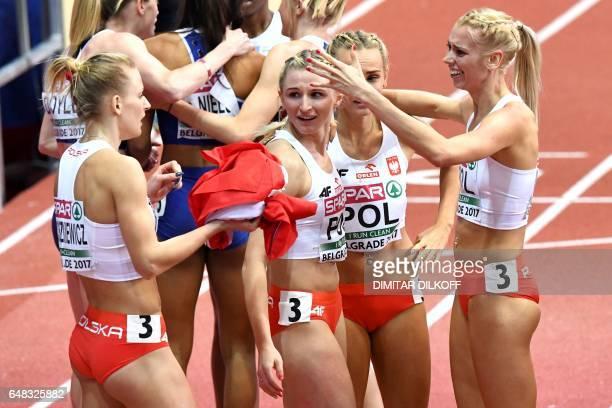 Poland's Patrycja Wyciszkiewicz Malgorzata Holub Justyna Swiety and Iga Baumgart celebrate after winning the women's 4x400m relay final at the 2017...