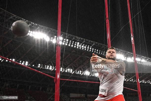 Poland's Pawel Fajdek competes in the men's hammer throw final during the Tokyo 2020 Olympic Games at the Olympic Stadium in Tokyo on August 4, 2021.