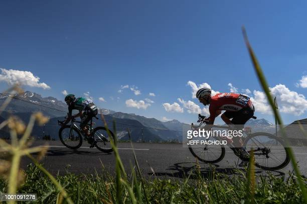 Poland's Pawel Poljanski and Poland's Tomasz Marczynski ride down the Saisies pass following the ascent of Bisanne during the eleventh stage of the...