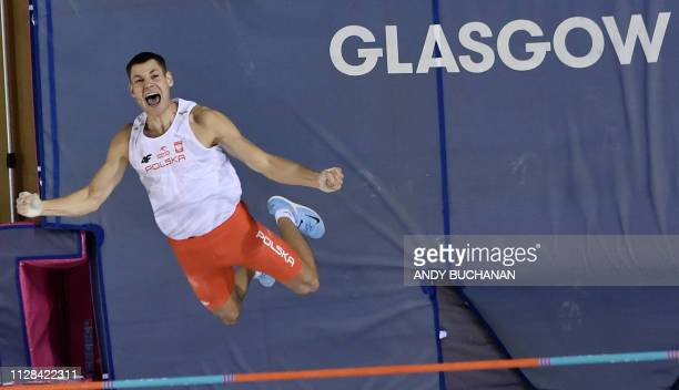 Poland's Pawel Wojciechowski competes to win the mens pole vault final event at the 2019 European Athletics Indoor Championships in Glasgow on March...