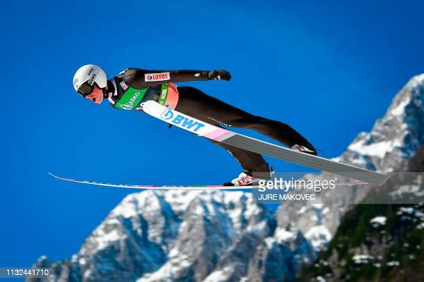 TOPSHOT Poland's Piotr Zyla jumps during the trial round of the FIS Ski Jumping World Cup Flying Hill Individual competition in Planica on March 24...