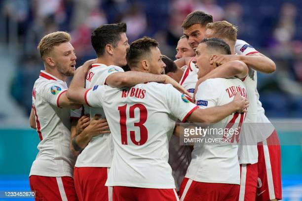 Poland's players celebrate after scoring their team's first goal during the UEFA EURO 2020 Group E football match between Poland and Slovakia at the...
